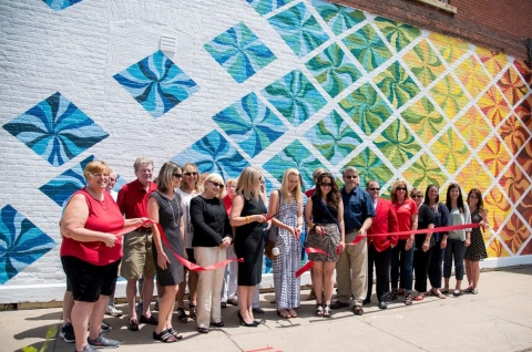 Ribbon cutting ceremony for new mural in Clinton, IA