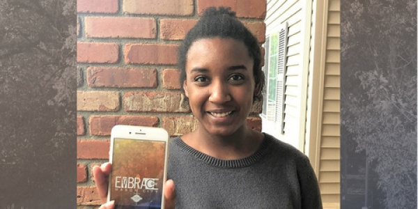 Kaisha Billings displays the Mason City mobile app interface.