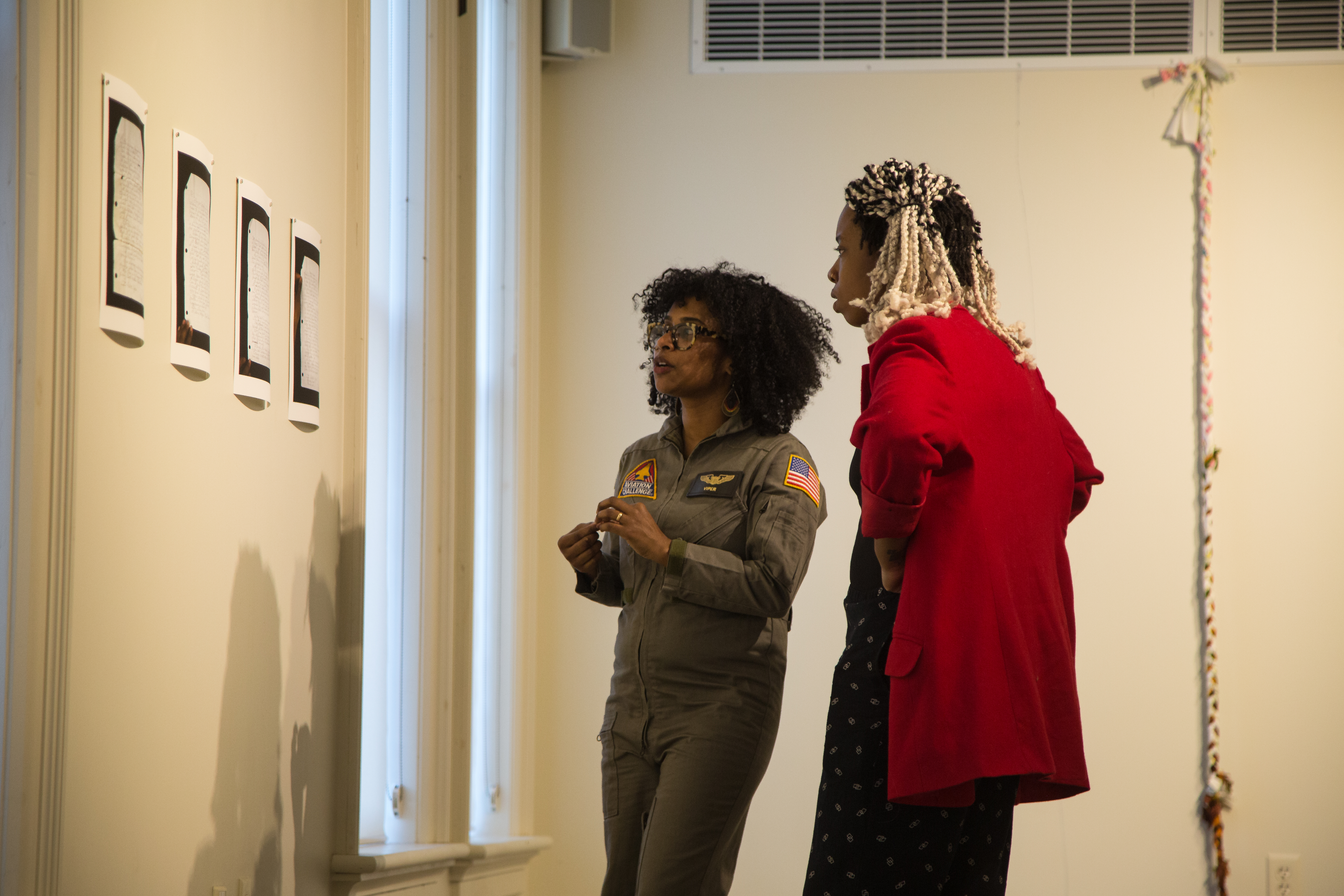 Grant Wood Fellow Tameka Norris and Anaïs Duplan at the Grant Wood Fellows Exhibition 2016-17 at C.S.P.S. Hall, Cedar Rapids, Iowa.